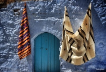 """28-Mar-2015: Chefchaouen, Morocco. The sights... sounds... smells... the city SCENE. Walking the streets of Chefchaouen, also known as the """"Blue City."""" It is such a uniquely cute little town. And, YES, almost everything is a shade of blue - with the exception of the BRIGHTLY colored woven fabrics and handicrafts."""