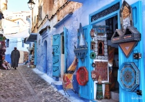 "28-Mar-2015: Chefchaouen, Morocco. The sights... sounds... smells... the city SCENE. Walking the streets of Chefchaouen, also known as the ""Blue City."" It is such a uniquely cute little town. And, YES, almost everything is a shade of blue - with the exception of the BRIGHTLY colored woven fabrics and handicrafts."